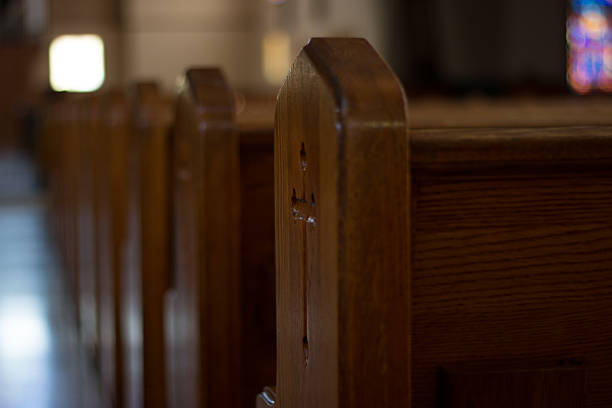 Church Pews, with a Cross Church Pews, Religious Themes pew stock pictures, royalty-free photos & images