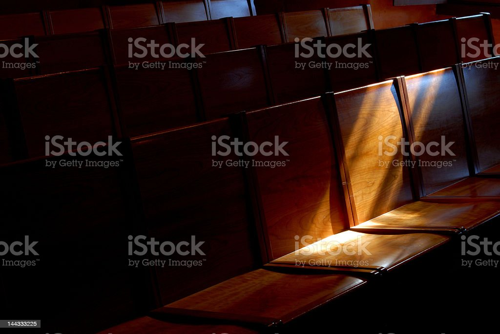 Church pews with stream of light royalty-free stock photo