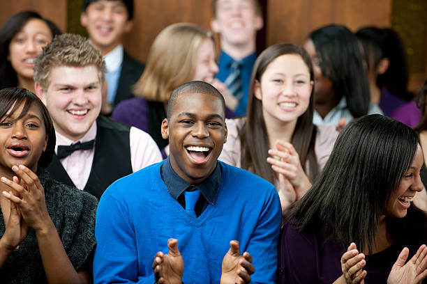 Church A diverse group of young adults at church - Buy credits pew stock pictures, royalty-free photos & images