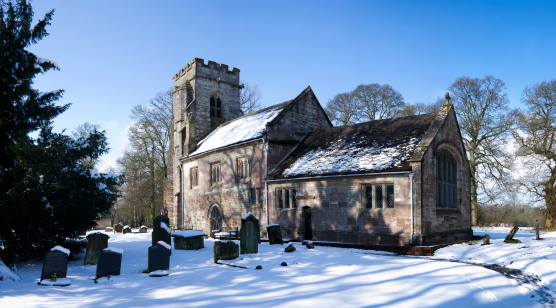 a parish church and a snow covered churchyard