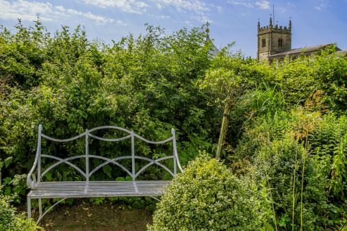 church tower behind an old walled garden