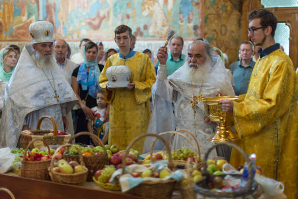 Church rite of sanctification of apples and grapes in honor of the feast Transfiguration of the Lord. stock photo