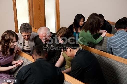 Group prayer during a church service - Buy credits