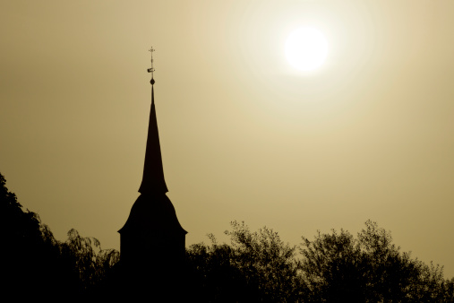 Church Spire in Boizenburg (Germany) at Sunrise