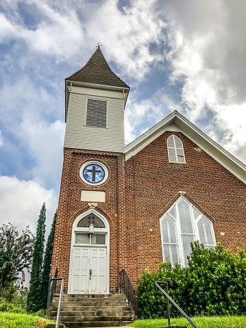 A church spire stretches toward the sky, in Georgia.