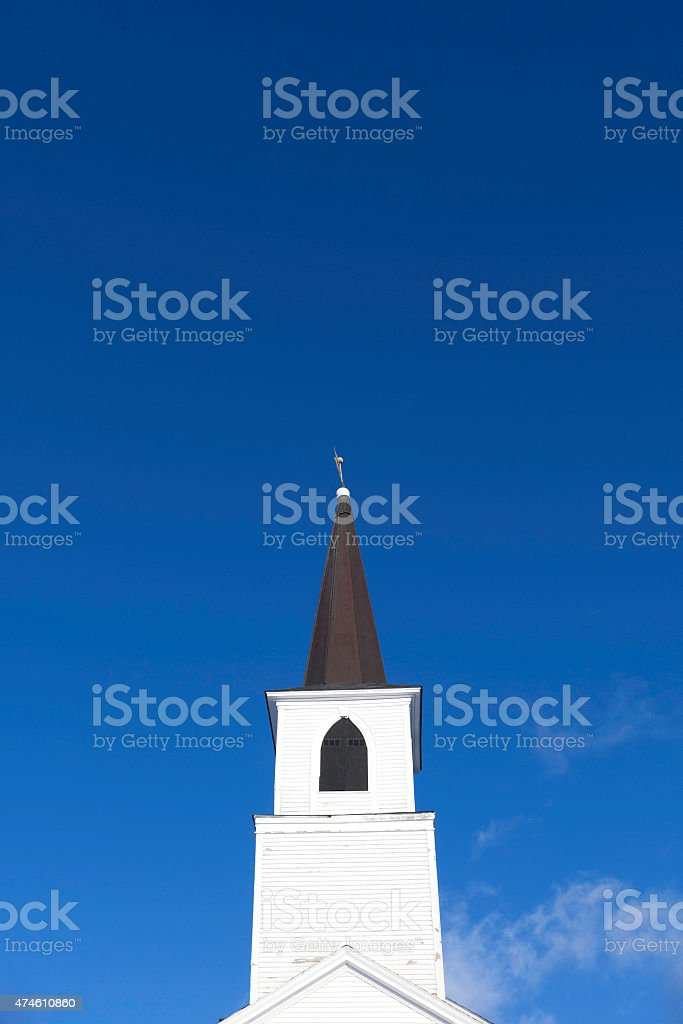 Church steeple against blue sky with clouds stock photo