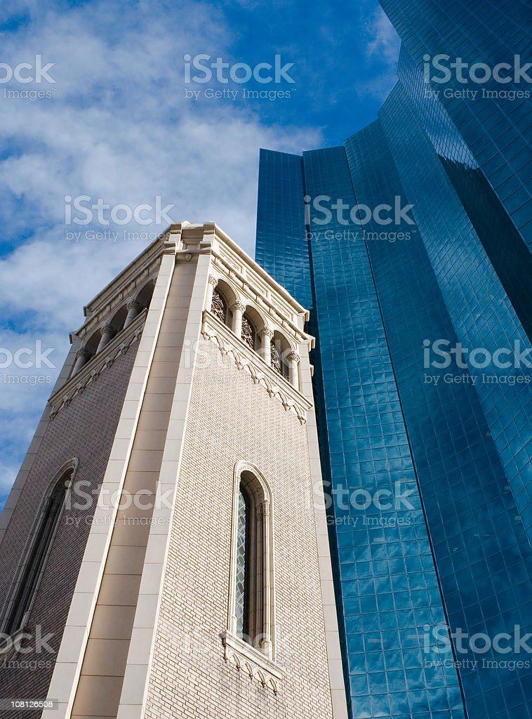 Church Steeple Beside Modern Glass Building royalty-free stock photo