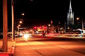 Church steeple towering over main street USA