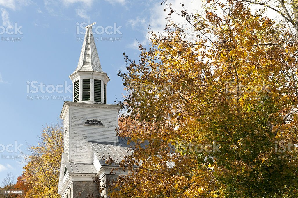 Church steeple with Autumn foliage stock photo