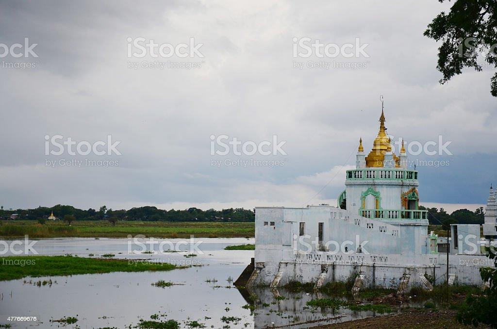 Church temple beside U Bein Bridge stock photo