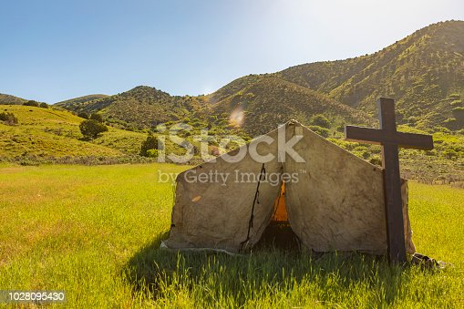 Cowboy Church Tent and Cross in a Field at Dawn