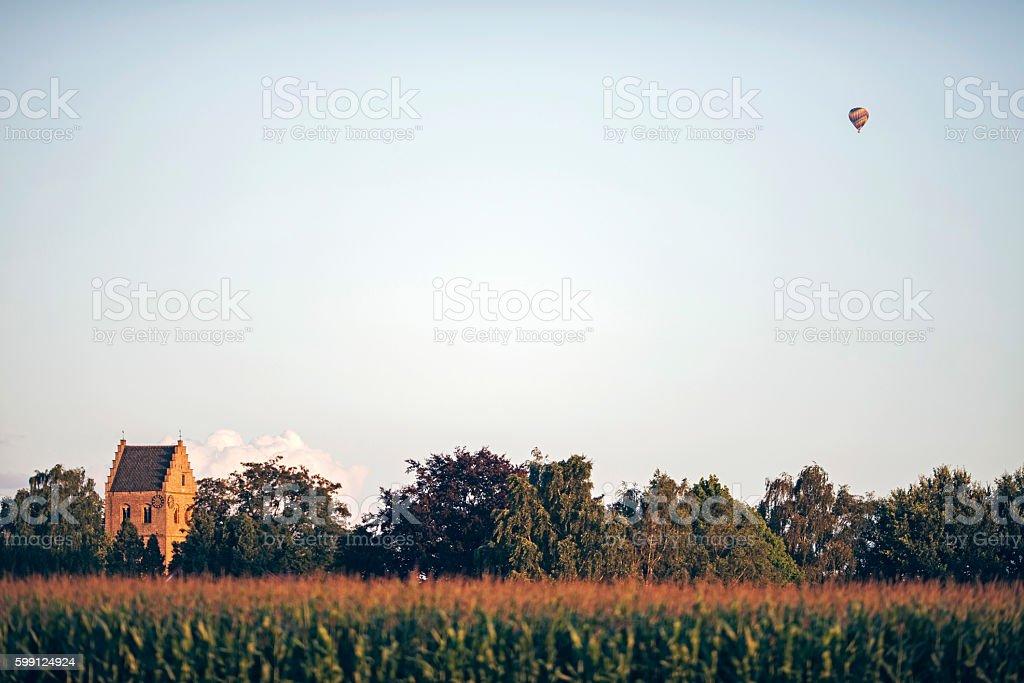 Church tower and air balloon over corn field. Geesteren. Achterhoek. stock photo