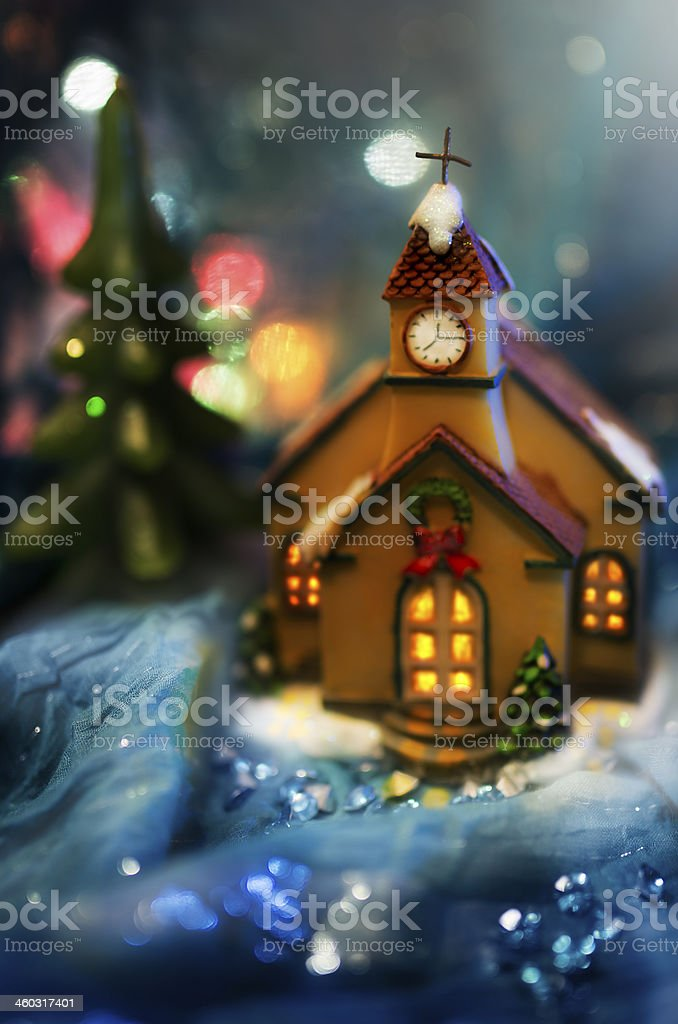 Church tower and Christmas tree on blue background with lights stock photo
