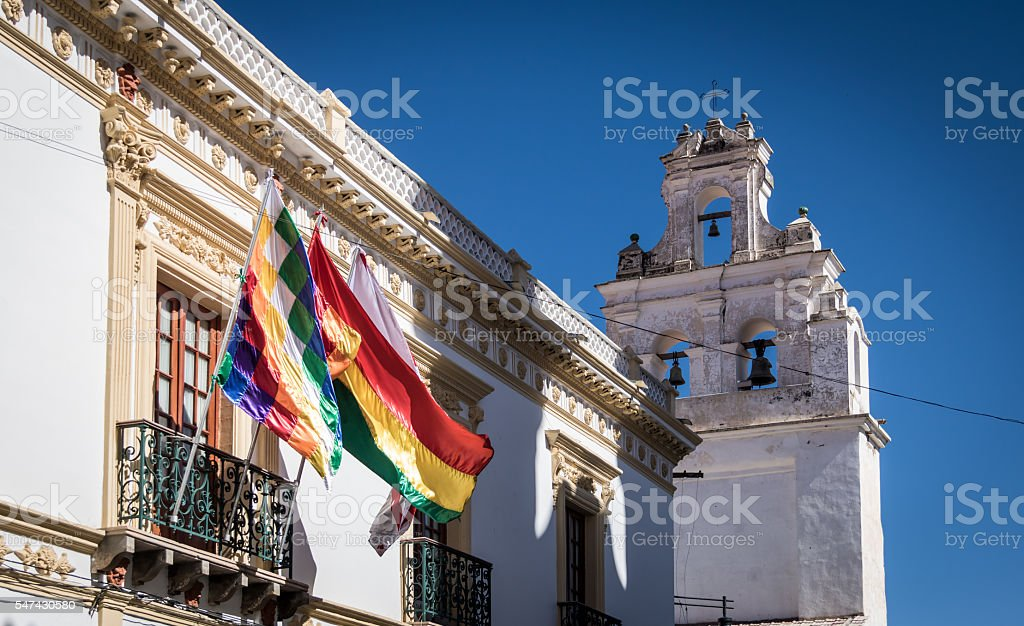 Church tower and Wiphala and Bolivia Flags - Sucre, Bolivia stock photo