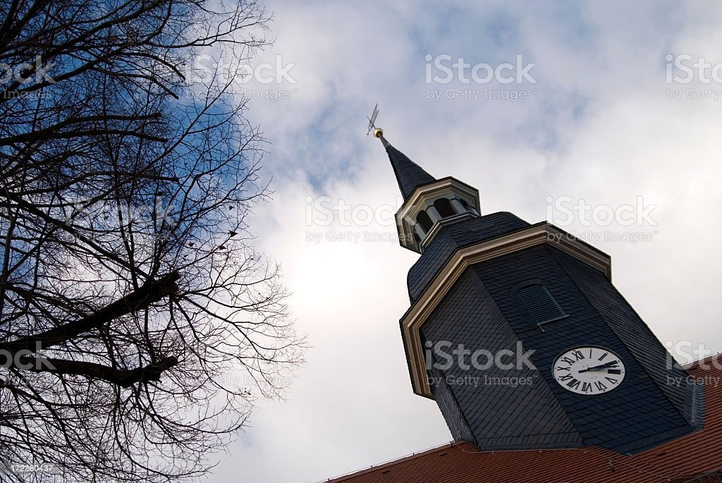 Church Tower In A Village With Clouds stock photo
