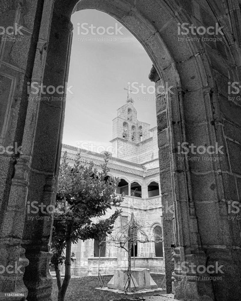 Church tower through arch at Ávila, Spain. stock photo