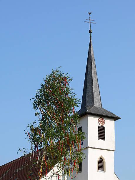 church tower with may tree - klokkentoren met luidende klokken stockfoto's en -beelden