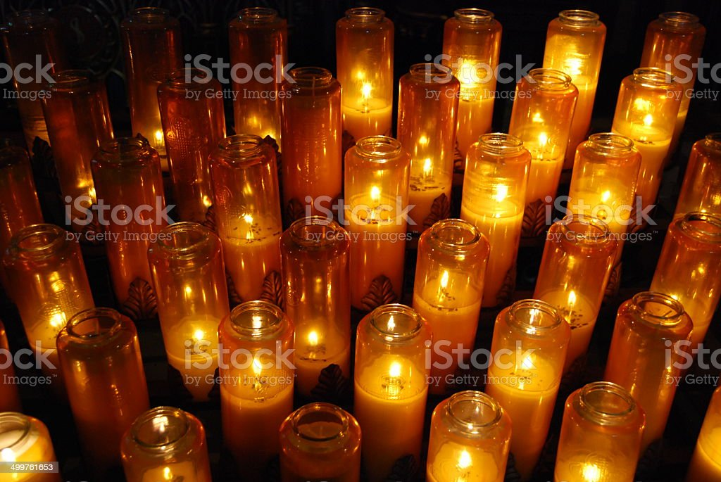 Church votive prayer candles in jars stock photo