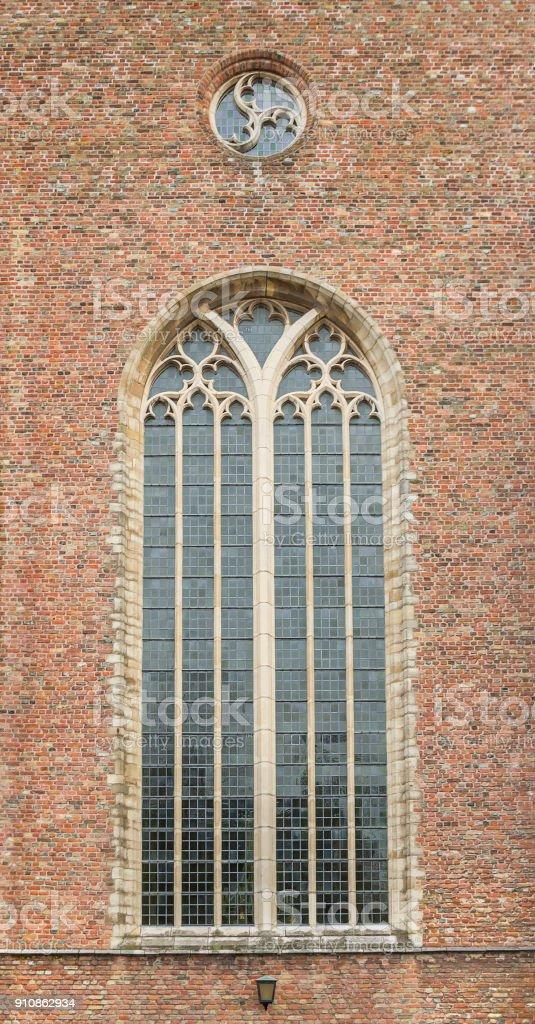 church window and brick wall stock photo