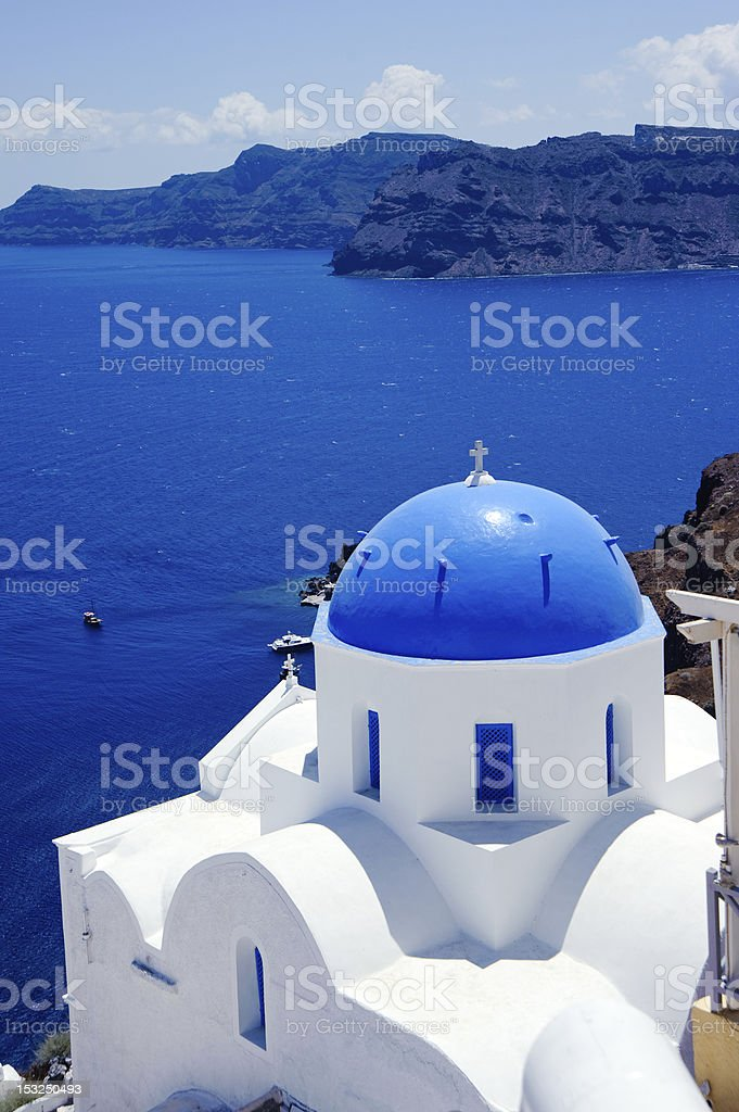 Church with a blue roof in Oia, a Santorini island in Greece royalty-free stock photo