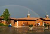 Church with a rainbow in the sky in the ecumenical camp in Taizé, Burgundy