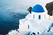 istock Church with blue dome in Santorini 1281543551