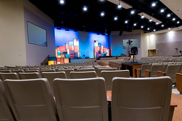Church with Blue Lit Stage  place of worship stock pictures, royalty-free photos & images