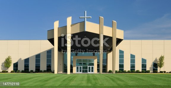 Modern church with symmetrical design under clear blue sky