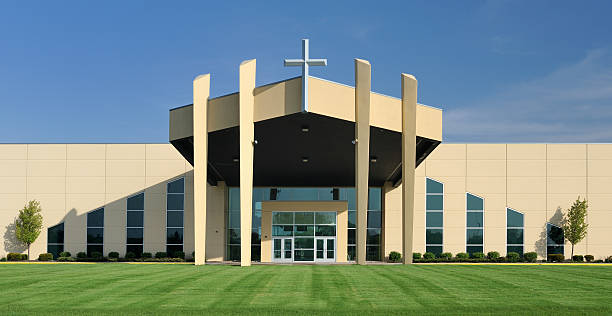 Church with Symmetrical Design Modern church with symmetrical design under clear blue sky church stock pictures, royalty-free photos & images