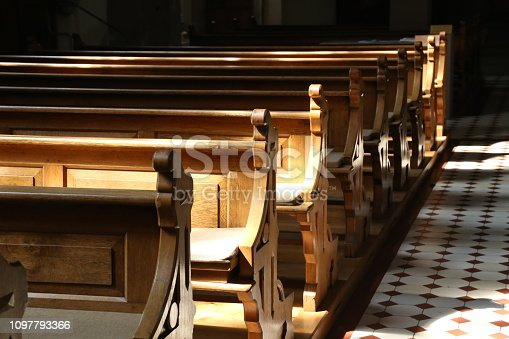 istock Church wooden bench 1097793366
