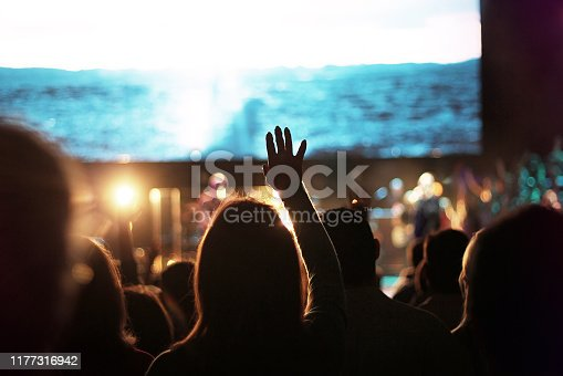 crowd worship worshipping worshipper church Sunday hand hand up hands up sing singing choir easter concert production band music song songs sing singing