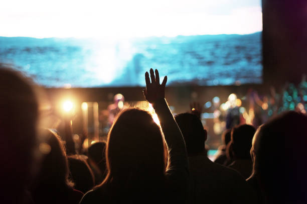 Church Worship Crowd crowd worship worshipping worshipper church Sunday hand hand up hands up sing singing choir easter concert production band music song songs sing singing place of worship stock pictures, royalty-free photos & images