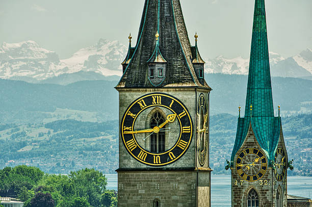 Churches in Zurich HDR June 2016, Saint Peter and Fraumünster Church in Zurich (Switzerland) in front of lake Zurich and the Swiss Alps, HDR-technique fraumunster stock pictures, royalty-free photos & images