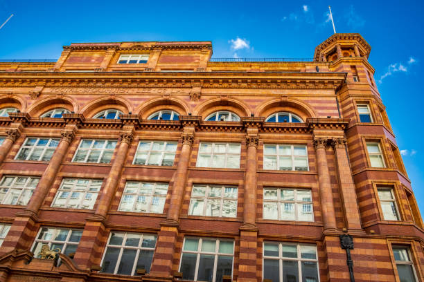 Churchgate House or Tootal Broadhurst and Lee building facade in Manchester, dated 1896, set against the blue sky stock photo