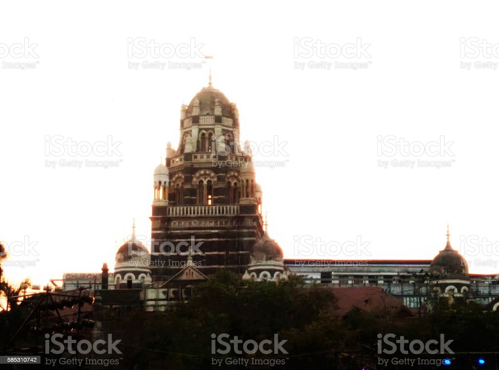 Churchgate Railway Station Evening shot of Churchgate Railway Station surrounded by trees. It was opened in 1867, it is one of the busiest stations in Mumbai city. Architecture Stock Photo