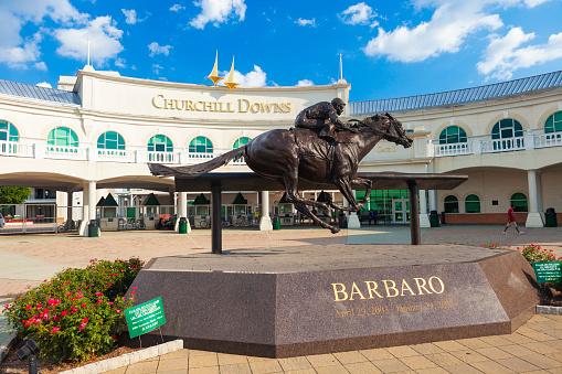 Louisville, Kentucky, USA - August 16, 2015:  Churchill Downs in Louisville, Kentucky with a statue of the Kentucky Derby winning horse, Barbaro.
