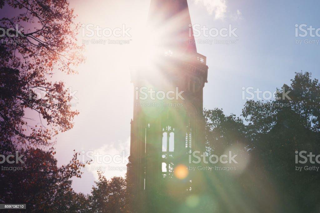 Churchtower in autumn stock photo