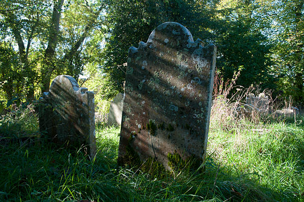 churchyard cemetery and gravestones stock photo