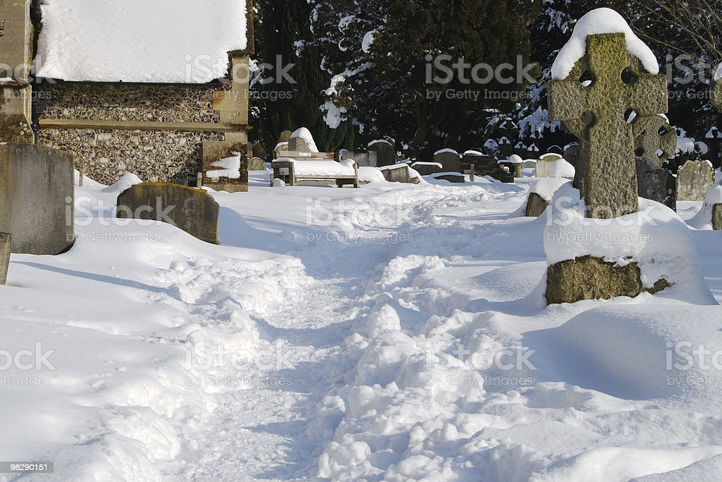 Churchyard under snow royalty-free stock photo