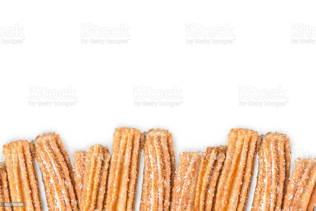 Churros arranged in row isolated on white background stock photo