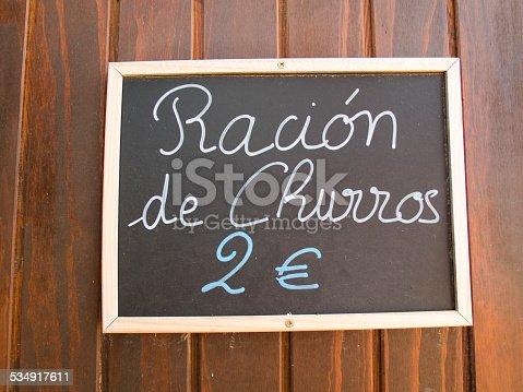 508216406 istock photo churros ration in blackboard 534917611