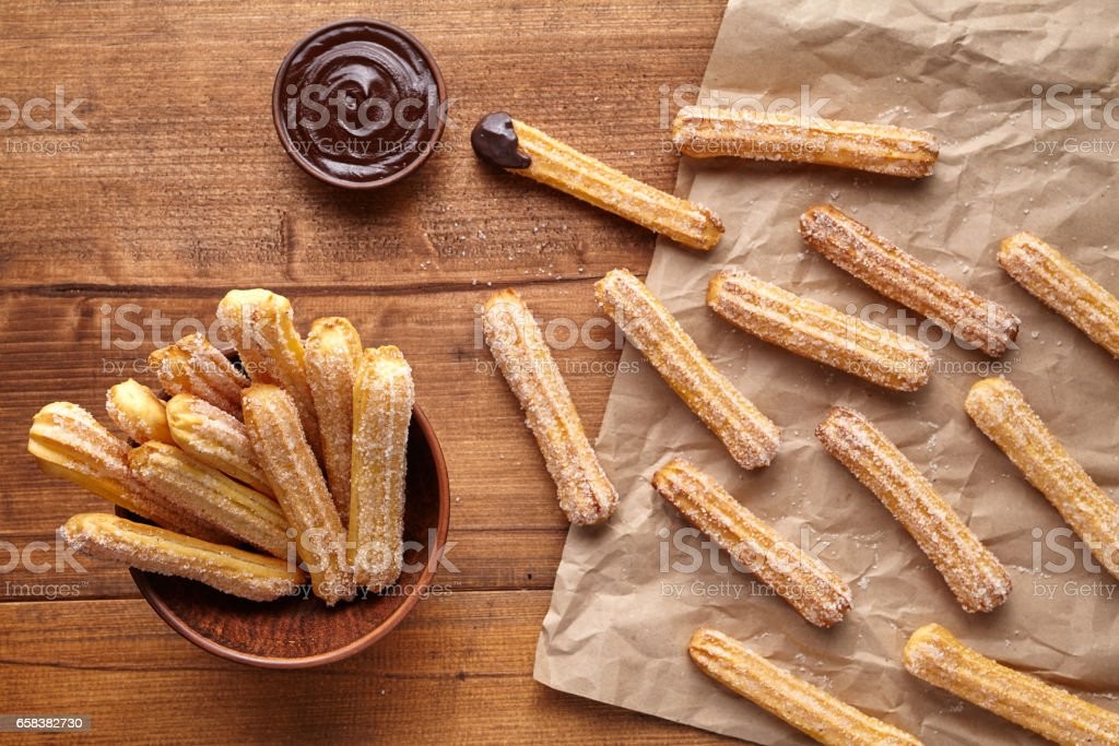 Churros traditional Spain culture breakfast or lunch sweet dough dessert baked pastry food snack stock photo