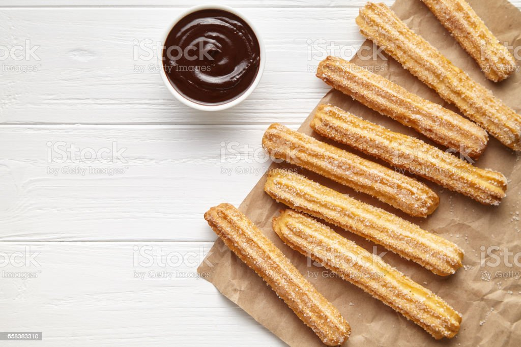 Churros traditional Spain street fast food baked sweet dough snack with chocolate stock photo