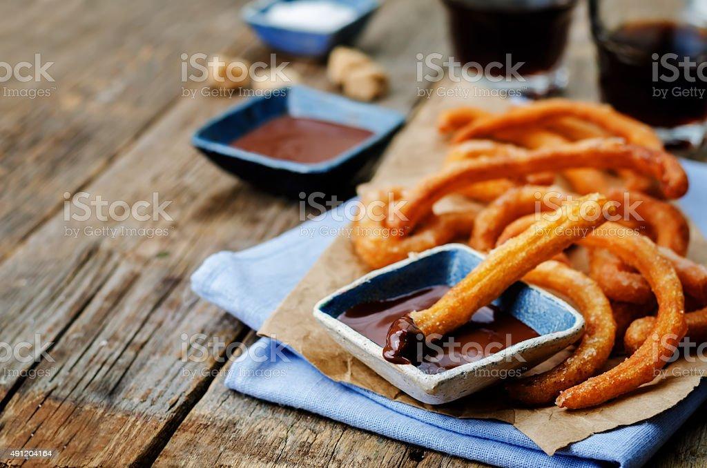 churros with chocolate sauce stock photo