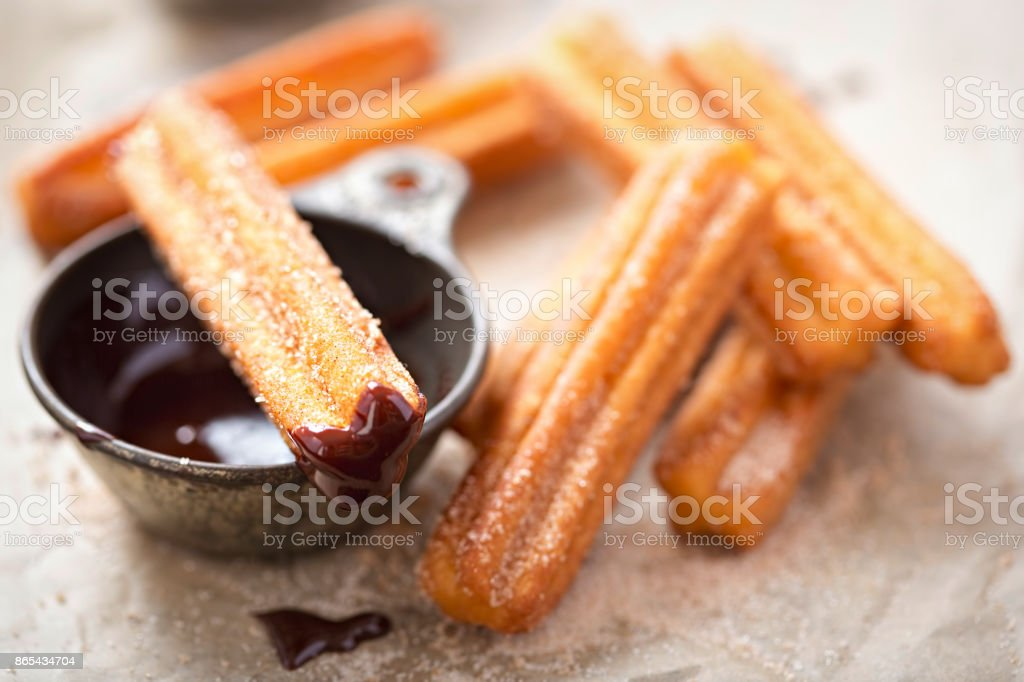 Churros with sugar and chocolate sauce stock photo