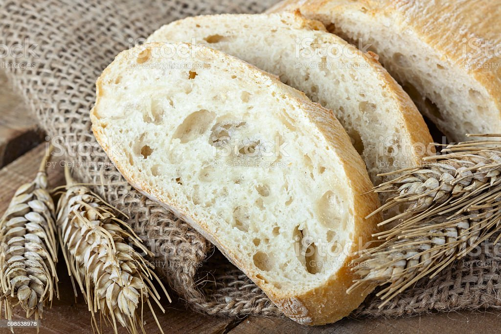 ciabatta and wheat on with background photo libre de droits