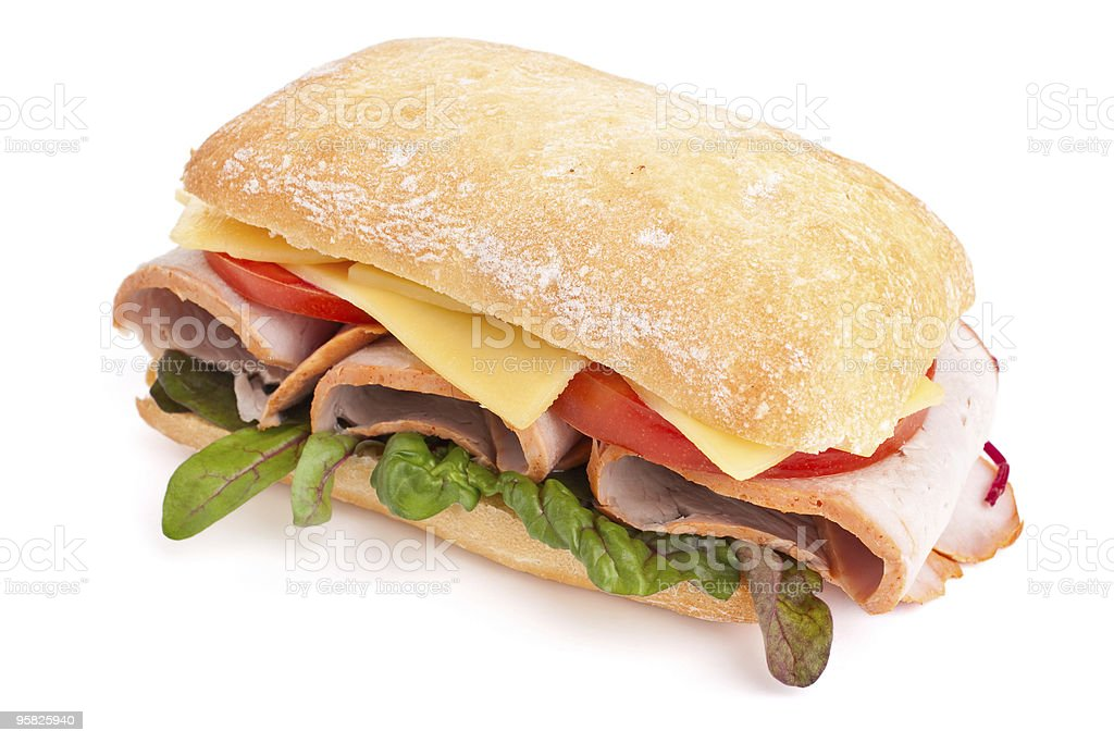 Ciabatta bread sandwich stuffed meat, cheese and vegetables royalty-free stock photo