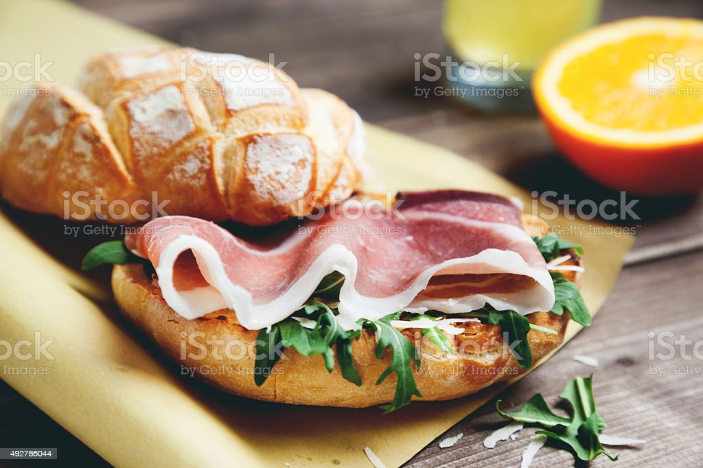 ciabatta bread with prosciutto parmesan and arugula stock photo
