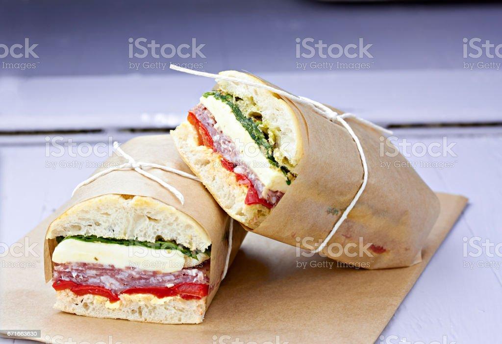 Ciabatta pressed sandwich salami mozarella spinach red pepper stock photo