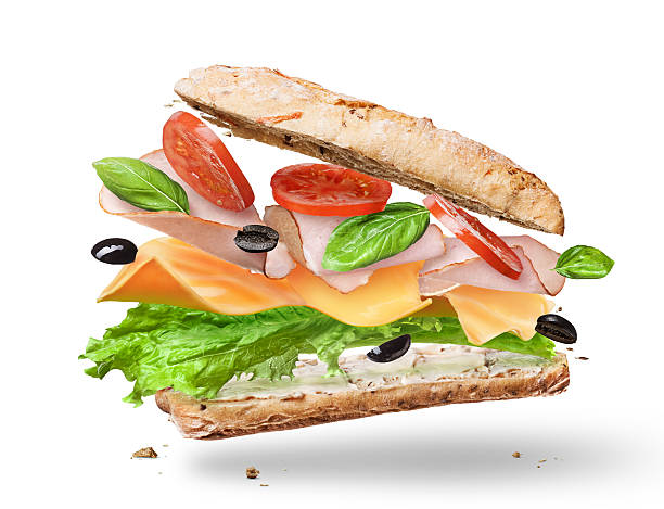 Ciabatta Sandwich with Lettuce, Tomatoes, Ham Ciabatta Sandwich with Lettuce, Tomatoes, Ham and Cheese cutted in half flying in the air submarine sandwich stock pictures, royalty-free photos & images